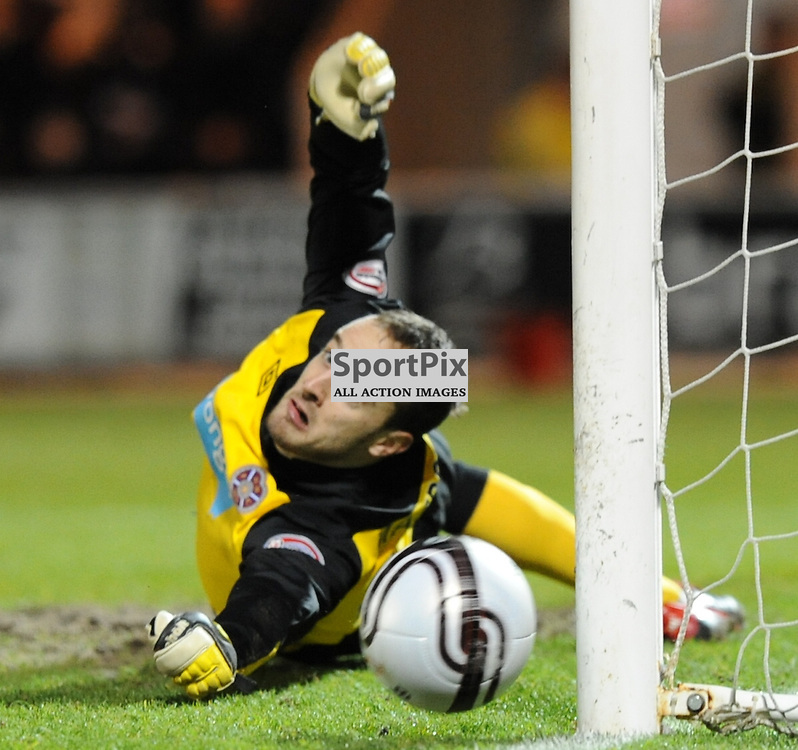 Hearts jamie MacDonald's penalty save from St Mirrens Graham Carey in the Scottish Cup Quater Final Replay match at St Mirren Park, Paisley on 21st March 2012..