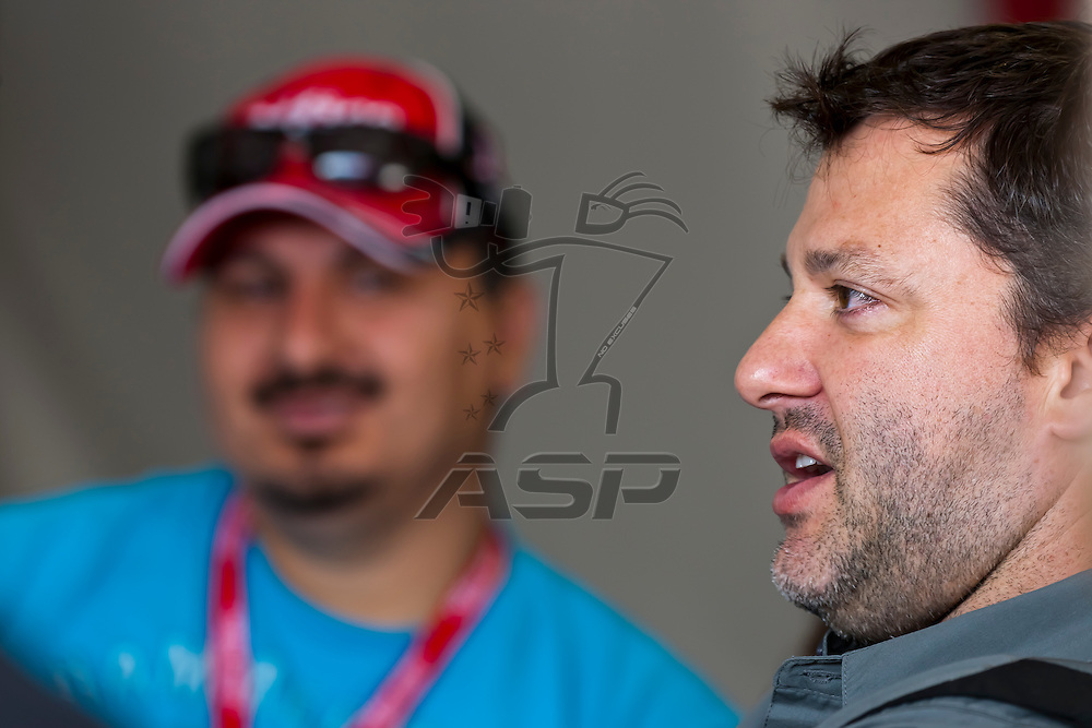 FONTANA, CA - MAR 25, 2012:  Tony Stewart (14) takes time out to talk to guests of Office Depot during the Auto Club 400 at the Auto Club Speedway in Fontana, CA.