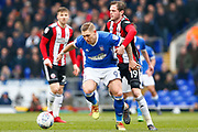Sheffield United defender Richard Stearman (19) fouls Ipswich Town striker Martyn Waghorn (9) during the EFL Sky Bet Championship match between Ipswich Town and Sheffield United at Portman Road, Ipswich, England on 10 March 2018. Picture by Phil Chaplin.
