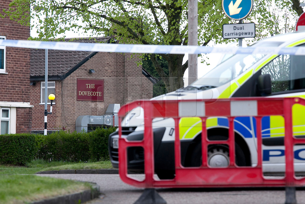 © Licensed to London News Pictures. 11/05/2013. Birmingham, UK. The scene in Cockshut Hill, Yardley, Birmingham, after a man was shot dead outside the Dovecote Public House. Pictured, Police outside the Public House. Photo credit : Dave Warren/LNP
