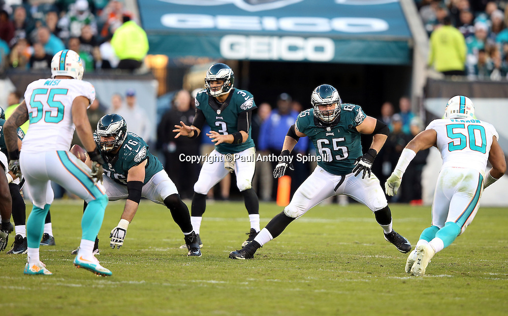 Philadelphia Eagles tackle Lane Johnson (65) looks to block Miami Dolphins defensive end Olivier Vernon (50) during the 2015 week 10 regular season NFL football game against the Miami Dolphins on Sunday, Nov. 15, 2015 in Philadelphia. The Dolphins won the game 20-19. (©Paul Anthony Spinelli)