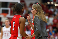 March 21, 2011; Stanford, CA, USA; St. John's Red Storm head coach Kim Barnes Arico (right) talks to guard Nadirah McKenith (5) during the first half of the second round of the 2011 NCAA women's basketball tournament against the Stanford Cardinal at Maples Pavilion.