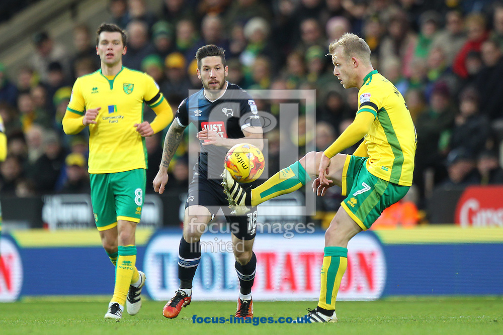 Steven Naismith of Norwich and Jacob Butterfield of Derby County in action during the Sky Bet Championship match at Carrow Road, Norwich<br /> Picture by Paul Chesterton/Focus Images Ltd +44 7904 640267<br /> 02/01/2017