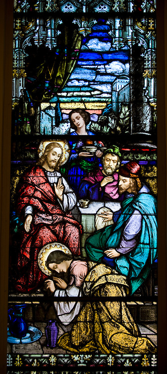 Stained glass image inside Sacred Heart Church, Sherwood, Wis., depicting the sinful woman washing Jesus' feet, as described in Luke's Gospel. (Sam Lucero photo)