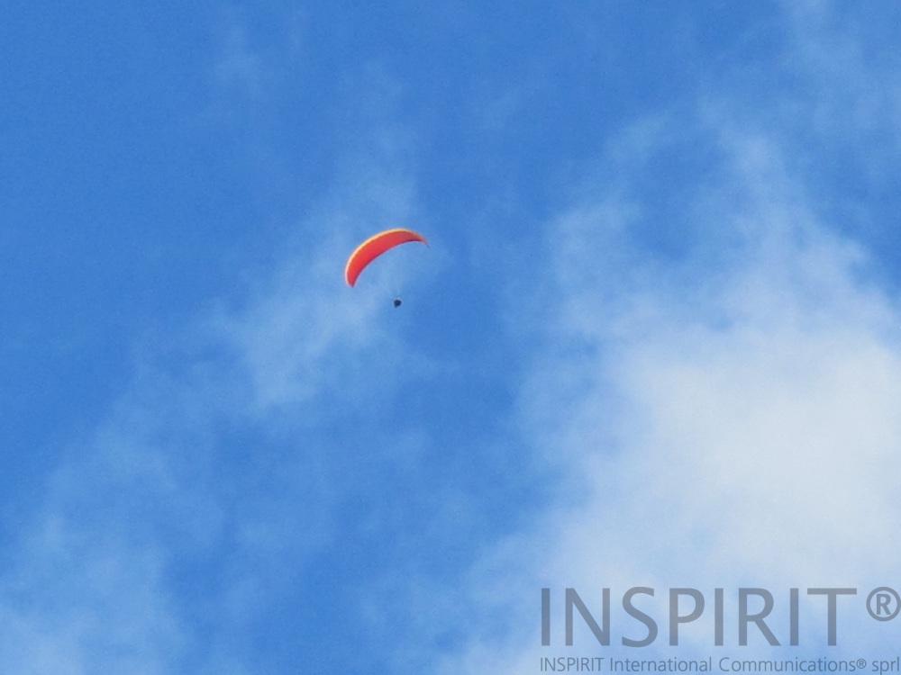 Man paragliding over the village of Chamonix. Photo: Tuuli Sauren / Inspirit International Communications