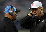 Detroit Lions head coach Jim Caldwell talks to an official during the NFL week 18 NFC Wild Card postseason football game against the Dallas Cowboys on Sunday, Jan. 4, 2015 in Arlington, Texas. The Cowboys won the game 24-20. ©Paul Anthony Spinelli