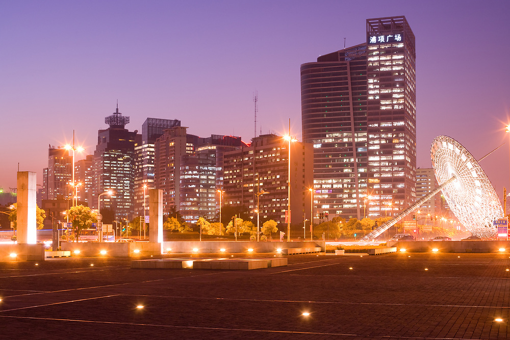 Shanghai, China - November 27, 2011: Skyline of office buildings from the intersection of Century Avenue and Yanggao Road with sundial sculpture on the right in Pudong district.