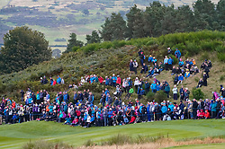 Auchterarder, Scotland, UK. 14 September 2019. Saturday afternoon Fourballs matches  at 2019 Solheim Cup on Centenary Course at Gleneagles. Pictured; Spectators on hillside beside the 8th fairway. Iain Masterton/Alamy Live News