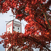 Photo of Frankfort Grainery through autumn trees in Frankfort Illinois. The Frankfort Grainery is a grain elevator and historic landmark in Frankfort Illinois. Frankfort is a Southwestern suburb of Chicago.