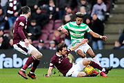 Connor Randall (#16) of Heart of Midlothian slides in to win the ball from Scott Sinclair (#11) of Celtic during the Ladbrokes Scottish Premiership match between Heart of Midlothian and Celtic at Tynecastle Stadium, Gorgie, Scotland on 17 December 2017. Photo by Craig Doyle.