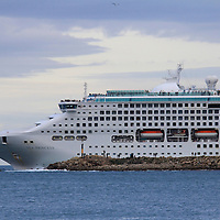 One of the many cruise liners visiting Dunedin in summer ,leaving Dunedin harbor / mouth