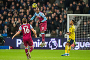 Angelo Ogbonna (West Ham) heading the ball with Mark Noble (Capt) (West Ham) & Pierre-Emerick Aubameyang (Capt) (Arsenal) close by during the Premier League match between West Ham United and Arsenal at the London Stadium, London, England on 9 December 2019.
