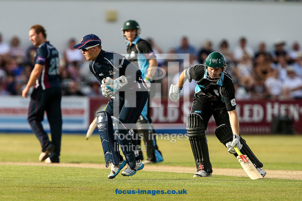 Ben Duckett of Northants Steelbacks (left) takes the ball as Chris Munro of Worcestershire Rapids (right) makes his ground safely during the Natwest T20 Blast match at the County Ground, Northampton<br /> Picture by Andy Kearns/Focus Images Ltd 0781 864 4264<br /> 18/07/2014