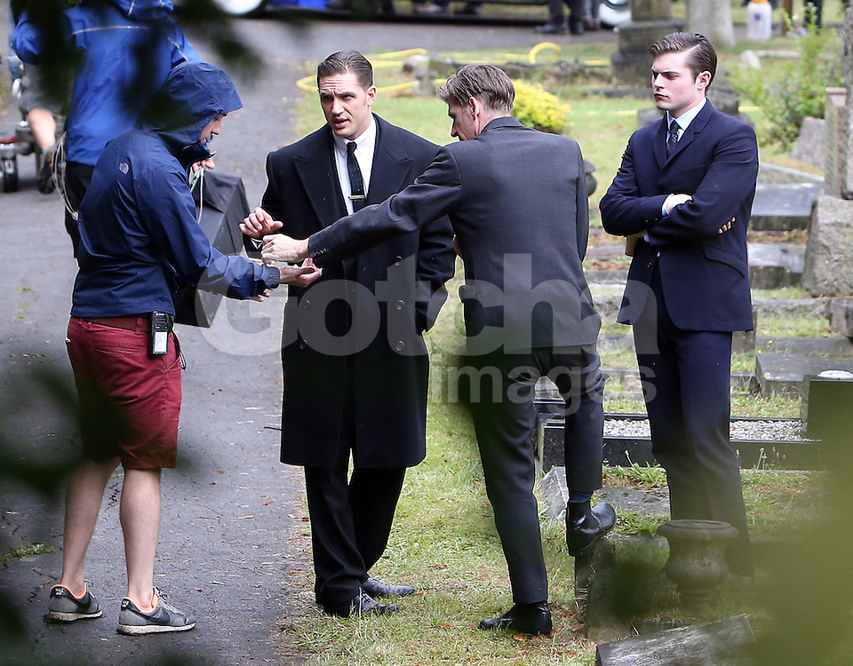 Tom Hardy on set of his new film 'Legend' where he plays both Kray brothers, in this scene he is Reggie Kray in the funeral of his wife that committed suicide. Kingston Cemetery in London, UK. 14/08/2014<br />BYLINE MUST READ : GOTCHAIMAGES.COM<br /><br />Copyright by &copy; Gotcha Images Ltd. All rights reserved.<br />Usage of this image is conditional upon the acceptance <br />of Gotcha Images Ltd, terms and conditions available at<br />www.gotchaimages.com