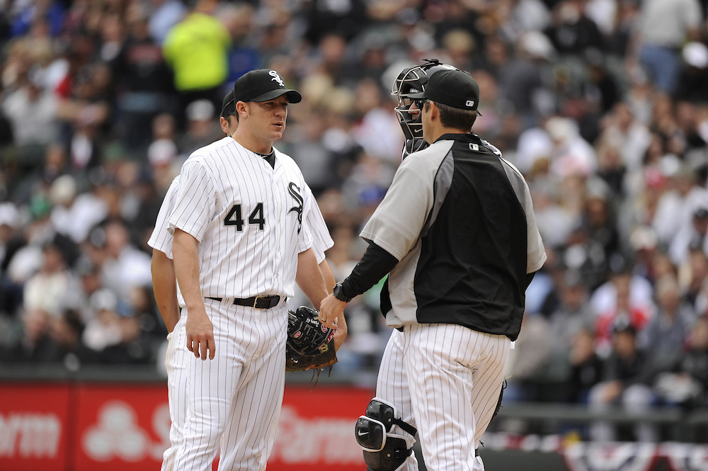 CHICAGO - APRIL 13:  Jake Peavy #44 is removed from the game by manger Robin Ventura #23 of the Chicago White Sox during the game against the Detroit Tigers on Opening Day, April 13, 2011 at U.S. Cellular Field in Chicago, Illinois.  The White Sox defeated the Tigers 5-2.  (Photo by Ron Vesely)   Subject:  Jake Peavy; Robin Ventura