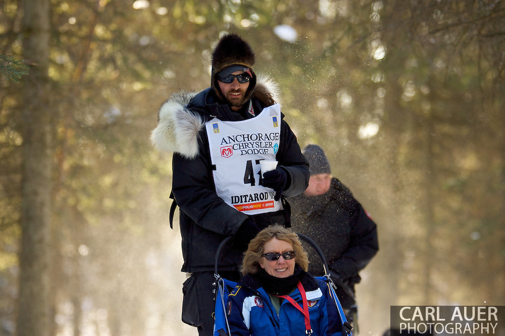 March 7th, 2009:  Anchorage, Alaska - The two time defending champion and two time ESPY nominee, Lance Mackey of Fairbanks, Alaska heads through the woods of Behm Lake during the 2009 Ceremonial Start of the Iditarod.