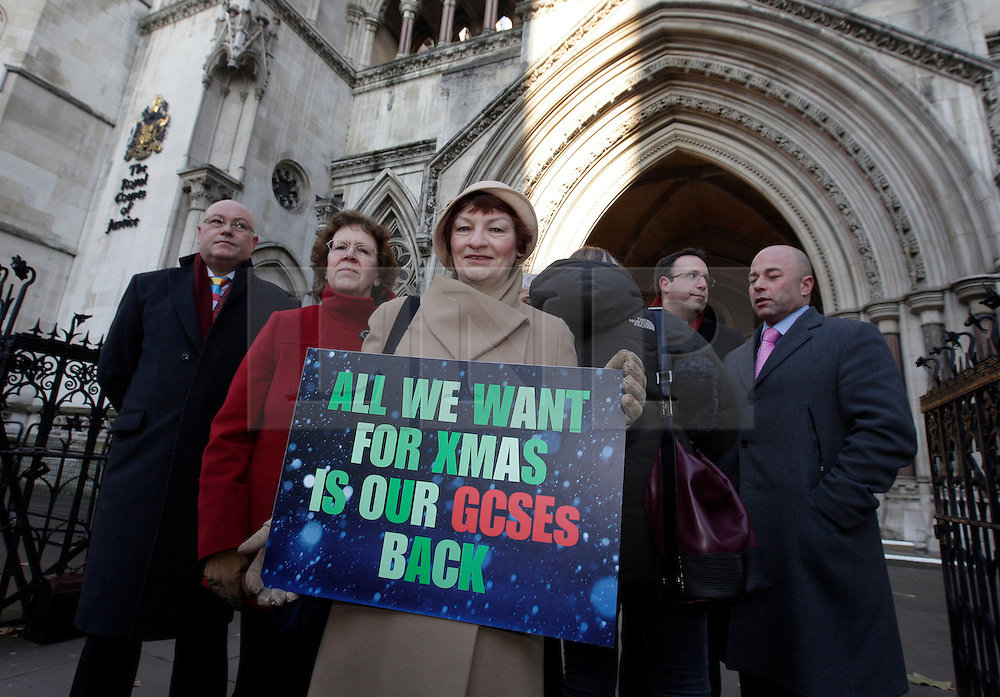 © Licensed to London News Pictures. 11/12/2012. London, U.K..GCSE English Exam CONTROVERSY. General Secretary of the NUT Christine Blower (CTR) talks outside the royal courts of justice today 11 december 2012 before hearing at the Royal Courts of justice of a legal challenge by an alliance of pupils, schools and councils over this summer's GCSE English examinations..Photo credit : Rich Bowen/LNP