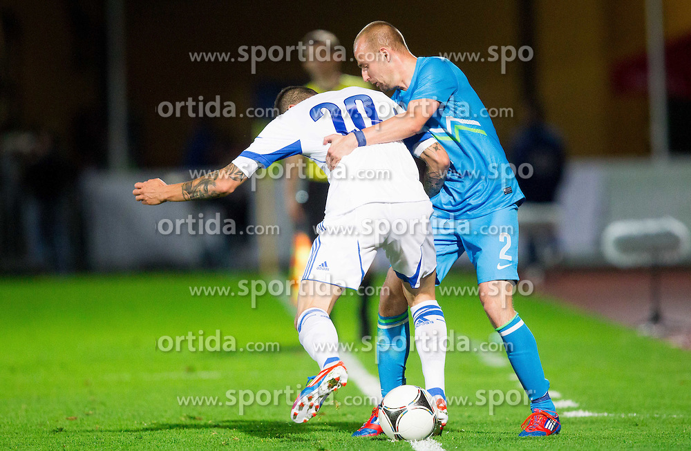 Kone Panagiotis of Greece vs Miso Brecko of Slovenia during friendly football match between national teams of Slovenia and Greece, on May 26, 2012 in Kufstein, Austria.   (Photo by Vid Ponikvar / Sportida.com)