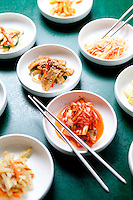 Korean appetizers called banchan which includes kimchi and fish cakes