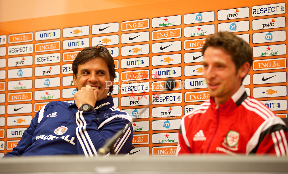 AMSTERDAM, NETHERLANDS - Tuesday, June 3, 2014: Wales' manager Chris Coleman and Joe Allen during a press conference at the Amsterdam Arena ahead of the International Friendly match against the Netherlands. (Pic by David Rawcliffe/Propaganda)