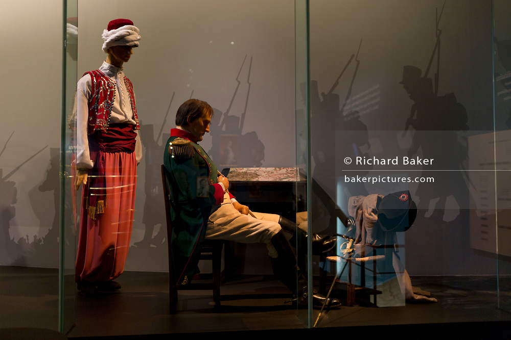A waxwork model of French Emperor Napoleon Bonaparte resting the night before the Battle of Waterloo, forms an exhibit inside the Memorial 1815 exhibition at the Waterloo battlefield, on 25th March 2017, at Waterloo, Belgium. Inaugurated on the battle's bicentenary, visitors experience the history of Napoleonic Europe and the armies of both the French and allied armies on that day. The Battle of Waterloo was fought 18 June 1815. A French army under Napoleon Bonaparte was defeated by two of the armies of the Seventh Coalition: an Anglo-led Allied army under the command of the Duke of Wellington, and a Prussian army under the command of Gebhard Leberecht von Blücher, resulting in 41,000 casualties.