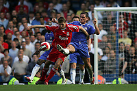Photo: Lee Earle.<br /> Chelsea v Liverpool. The Barclays Premiership. 17/09/2006. Liverpool's Steven Gerrard (L) battles with Frank Lampard.
