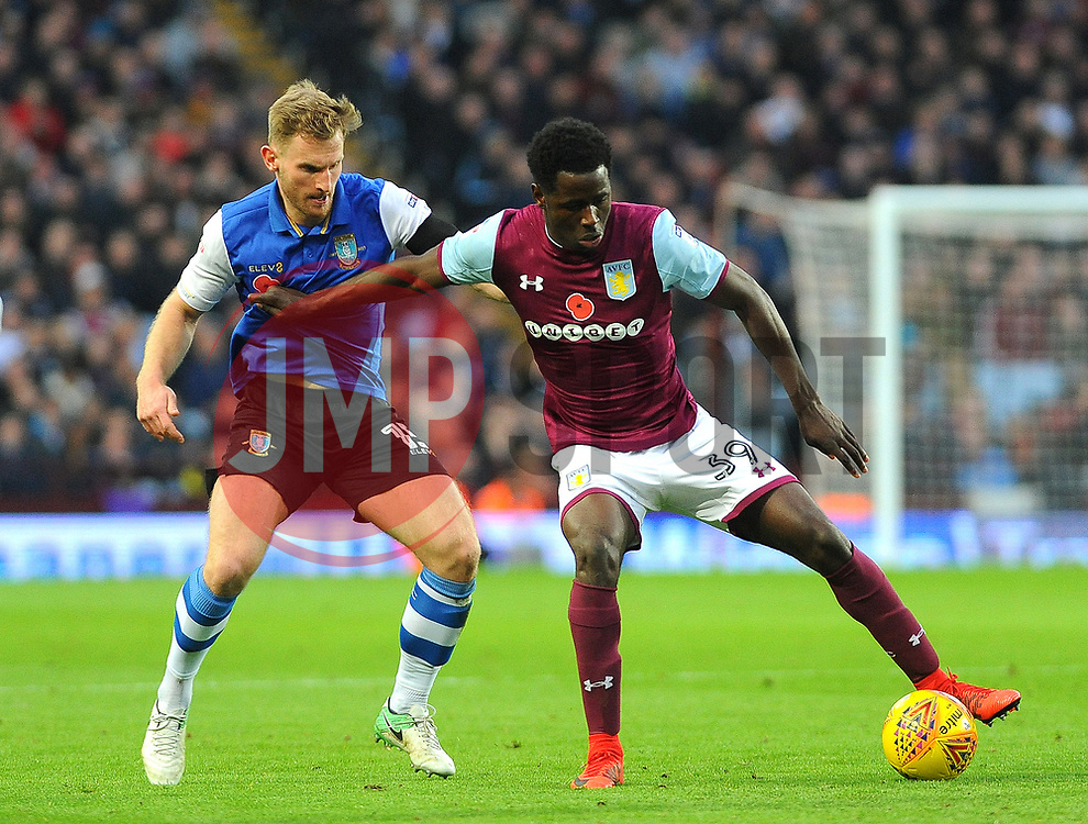 Keinan Davis of Aston Villa is under pressure from Tom Lees of Sheffield Wednesday- Mandatory by-line: Nizaam Jones/JMP - 04/11/2017 - FOOTBALL - Villa Park - Birmingham, England - Aston Villa v Sheffield Wednesday - Sky Bet Championship