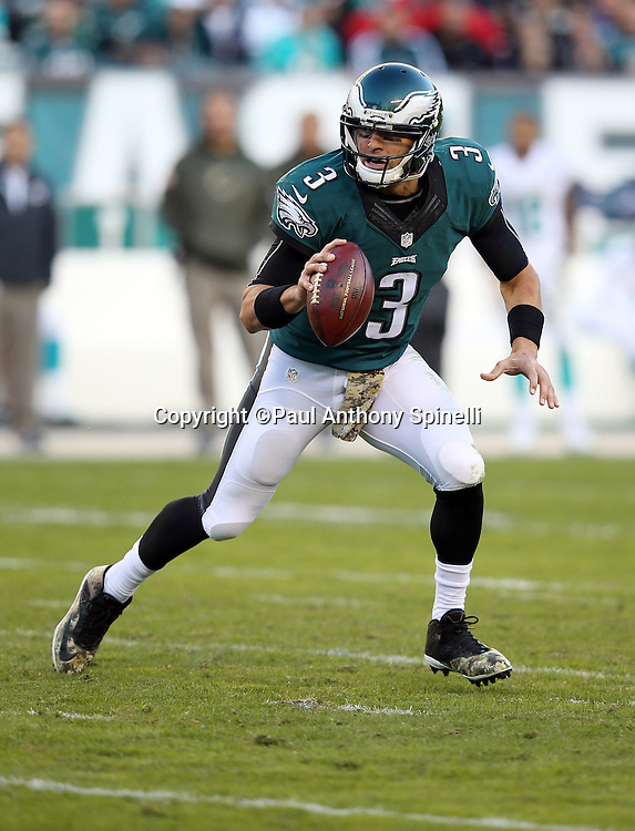 Philadelphia Eagles quarterback Mark Sanchez (3) scrambles while looking to pass during the 2015 week 10 regular season NFL football game against the Miami Dolphins on Sunday, Nov. 15, 2015 in Philadelphia. The Dolphins won the game 20-19. (©Paul Anthony Spinelli)