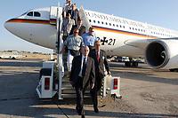 """10 AUG 2003, TASCHKENT/USBEKISTAN:<br /> Peter Struck (L), SPD, Bundesverteidigungsminister, in Begleitung von Dr. Martin Hecker (R), Deutscher Botschafter in Usbekistan, auf dem Weg zur Begruessung durch eine usbekische Delegation, im Hintergrund: Airbis A310 """"Konrad Adenauer"""" der Flugbereitschaft der Bundesluftwaffe mit dem neuen Schriftzug """"Bundesrepublik Deutschland"""", Flughafen Taschkent<br /> IMAGE: 20030810-01-032<br /> KEYWORDS: Bundeswehr, Streitkraefte, Streitkräfte, Praesidentenmaschine, Präsidentenmaschine, Luftwaffe, Airforce No 1, Flugzeug, Plane, Tashkent, Uzbekistan"""