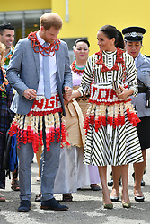RETRANSMITTED WITH NAME OF GARMENT ADDED The Duke and Duchess of Sussex wear ta'ovala, a traditional Tongan dress wrapped around the waist, as they visit an exhibition of handicrafts, mats and tapa cloths at the Fa'onelua Convention Centre on the second day of the royal couple's visit to Tonga.