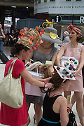 DAPHNE POLLIOT; ESTELLE LAMBERT, , ( MACAROON HAT ) FRENCH RACEGOERS ALL WEARING HATS BY POPPINS MILLINERY, Royal Ascot racegoers at Waterloo station. London. 20June 2013.
