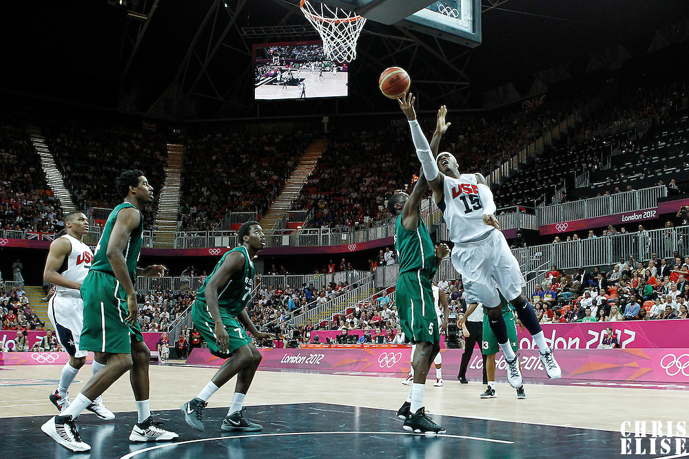 02 August 2012: USA Carmelo Anthony goes for the layup past Nigeria Ekene Ibekwe during 156-73 Team USA victory over Team Nigeria, during the men's basketball preliminary, at the Basketball Arena, in London, Great Britain.