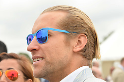 JAKE PARKINSON-SMITH at the Cartier Queen's Cup Polo final at Guard's Polo Club, Smiths Lawn, Windsor Great Park, Egham, Surrey on 14th June 2015