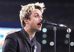 Sept 13, 2011; East Rutherford, NJ, USA; Green Day lead singer Billie Joe Armstrong performs with the band during the half time show of the New York Jets-Baltimore Ravens game at the New Meadowlands Stadium.