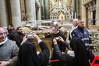 ROME, ITALY - 5 FEBRUARY 2016: Two nuns photograph the relic of Saint Pio, exposed here in the church of San Salvatore in Lauro in Rome, Italy, on February 5th 2016.<br /> <br /> Crowds of tens of thousands faithfuls and pilgrims greeted the arrival of the relics of Saint Pius of Pietrelcina – better known as Padre Pio – and Saint Leopold Mandic in Rome. On the afternoon of February 5h, the two saint will be taken in procession to St-Peter's basilica.<br /> <br /> Saint Pio and Saint Leopold were two Franciscans that lived in the 20th century and that are well known as confessors and spiritual guides. Pope Francis himself requested that the relics of the saints come to Rome, in part to inspire the ministry of the priests who have been chosen as Missionaries of Mercy for the Jubilee.