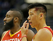 Houston Rockets' Jeremy Lin, right, reacts after colliding with Milwaukee Bucks' Larry Sanders during the second half of an NBA basketball game Friday, Jan. 4, 2013, in Milwaukee. At left is Rockets' James Harden. Lin left the game after the play.(AP Photo/Jeffrey Phelps)