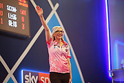Fallon Sherrock (England) celebrates after beating Mensur Suljovic (Serbia) (not in picture) in the Second Round of the PDC William Hill World Darts Championship at Alexandra Palace, London, United Kingdom on 21 December 2019.