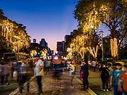 24 NOVEMBER 2018 - BANGKOK, THAILAND:  People walk into the Red Cross Fair in Lumpini Park. The Red Cross Fair is a fund raiser and annual event in Bangkok that draws thousands of attendees every night of its nine day run. The fair features games of chance, a midway with rides, handicrafts and food. This is the first year the fair has been in Lumpini Park. Previously it had been held in the Dusit section of Bangkok. The 2018 Fair marks 125 years of service for the Red Cross in Thailand.     PHOTO BY JACK KURTZ
