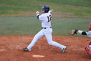 Ole Miss' Tanner Mathis (12) drives in Taylor Hightower at Oxford University Stadium in Oxford, Miss. on Wednesday, February 23, 2011.