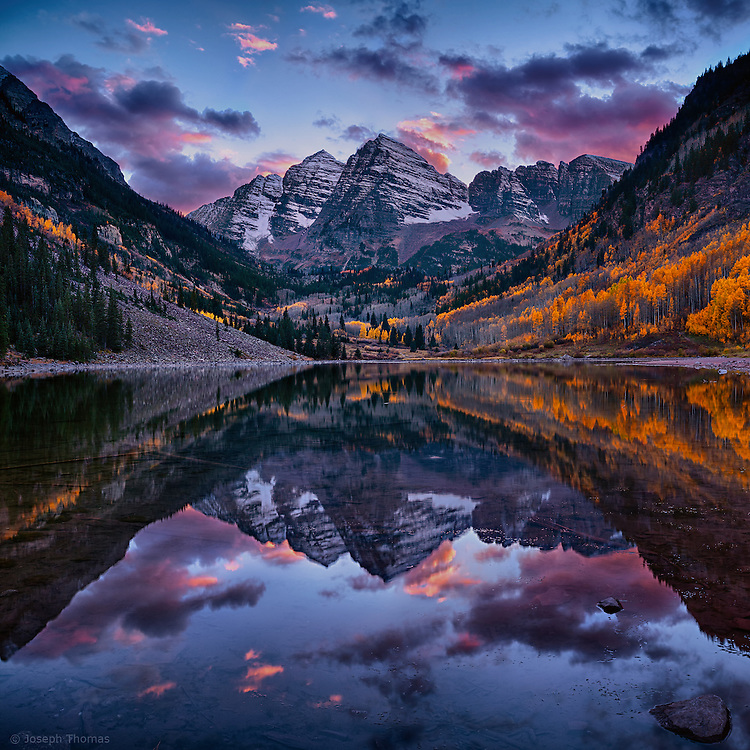 The striking symmetry of Maroon Bells is reflected in Maroon Lake on this perfect autumn day.<br />