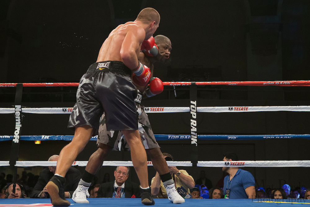 Derek Edwards (Black, White, and Grey Trunks) from Winston /Salem, NC, USA fights Matt Korobov (Grey with Black Trunks) from Orotukan, Russia in a 8 round Middleweight bout at Boardwalk Hall in Atlantic City, NJ on Saturday December 7, 2013. (photo / Mat Boyle