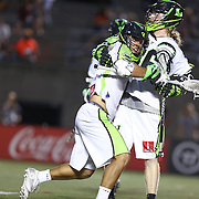 JoJo Marasco #1 of the New York Lizards celebrates his game winning goal with Matt Gibson #66 of the New York Lizards during the game at Harvard Stadium on July 19, 2014 in Boston, Massachusetts. (Photo by Elan Kawesch)