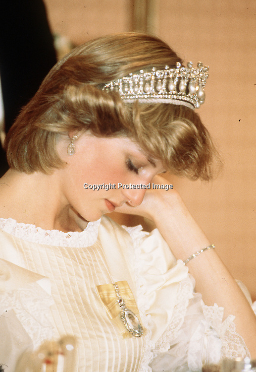 An exhausted Diana, Princess of Wales looks as though she's fallen asleep during a banquet in Canada in June 1983.Anbwar Hussein
