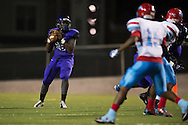 Malik Shellie of the Lincoln Tigers drops back to pass against the Carter Cowboys during a high school football game at Forester Stadium in Dallas, Texas on September 18, 2015. (Cooper Neill/Special Contributor)