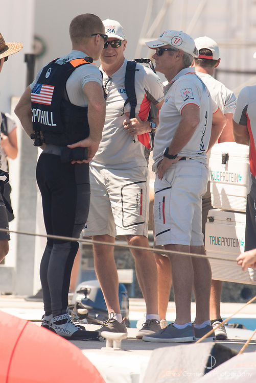 The Great Sound, Bermuda, 18th June. Oracle Team USA helmsman Jimmy Spithill (AUS) and Team General Manager / Chief Operating Officer Grant Simmer having a chat on the dock after their fourth loss in a row to Emirates Team New Zealand. Day two of the America's Cup.