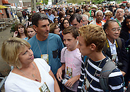 From left, Trish Miller, John Miller, Luke Miller, 12, and Jack Miller, 14 of Jenkintown, Pennsylvania wait in the line of people waiting to get through security for the Papal mass which stretched two blocks at noon near the Benjamin Franklin Parkway Sunday September 27, 2015 in Philadelphia, Pennsylvania.  (Photo By William Thomas Cain)