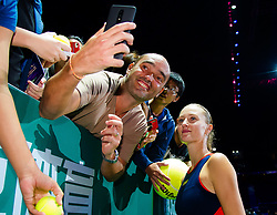 October 26, 2018 - Kallang, SINGAPORE - Kristina Mladenovic of France signs autographs after winning their doubles quarterfinal match at the 2018 WTA Finals tennis tournament (Credit Image: © AFP7 via ZUMA Wire)