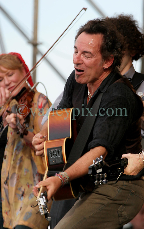 30 April 2006. New Orleans, Louisiana. Jazzfest . <br /> The first New Orleans Jazz and Heritage festival following the disaster of Hurricane Katrina. <br /> Music superstar Bruce Springsteen plays with the Seeger Sessions band on the Acura Stage.<br /> <br /> Photo ©Charlie Varley/varleypix.com<br /> All rights reserved.