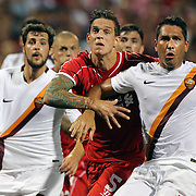 Daniel Agger, (left), Liverpool, holds Marco Borriello, AS Roma, during a corner in the Liverpool Vs AS Roma friendly pre season football match at Fenway Park, Boston. USA. 23rd July 2014. Photo Tim Clayton
