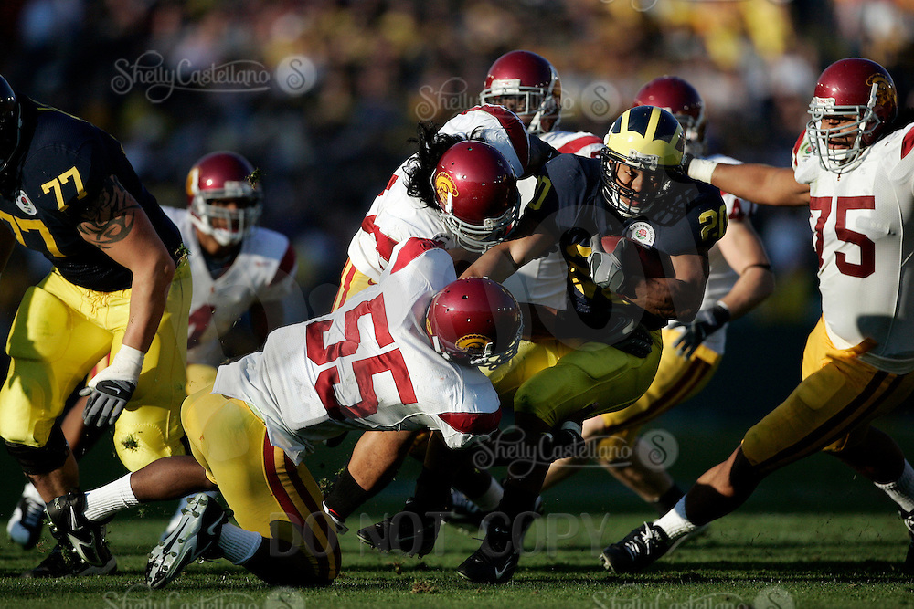 1 January 2007: Mike Hart gets taken down by Keith Rivers at the 93rd Rose Bowl Game at the Rose Bowl Stadium for the Pac-10 USC Trojans vs the Big-10 Michigan Wolverines NCAA college football game in Southern California.<br />